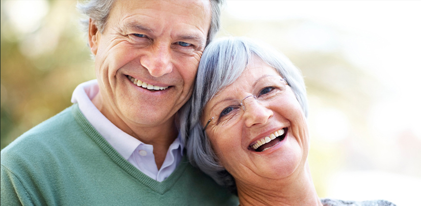 Closeup portrait of happy mature couple enjoying together - Outdoor
